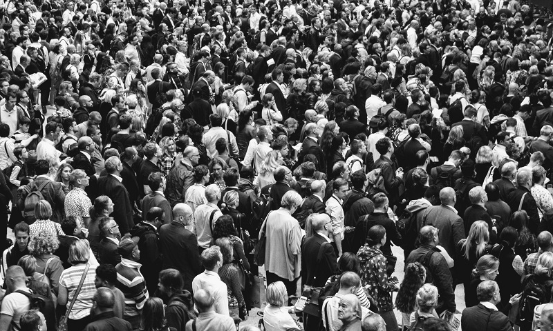 A mass amount of people standing